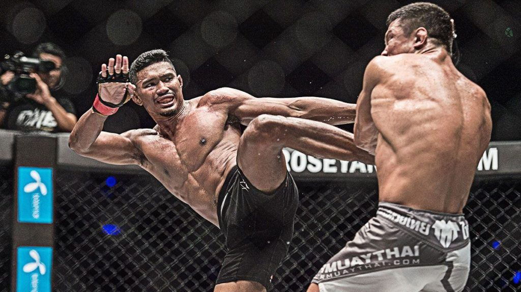 Amir Khan kicks during a ONE Championship fight